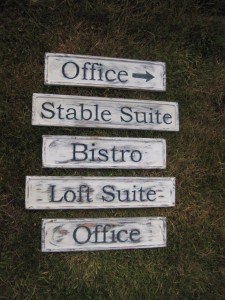 Rustic carved wood signs for a retirement facility
