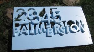 Cut letters in styrofoam for concrete form for concrete letters