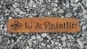 rustic steel direction sign