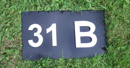 Polished welded stainless address plaque