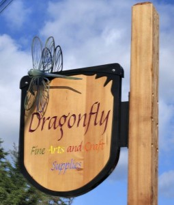 wood carved Dragonfly sign
