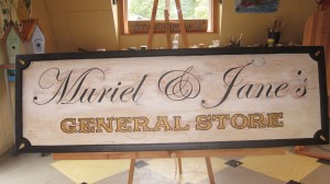 WOOD CARVED AND PAINT DISTRESSED SIGN